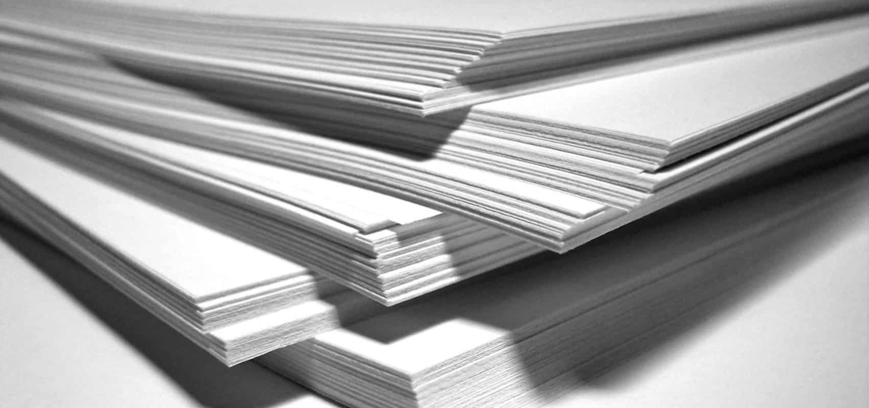 Cut sheets of Newsprint paper paper stacked ready for printing